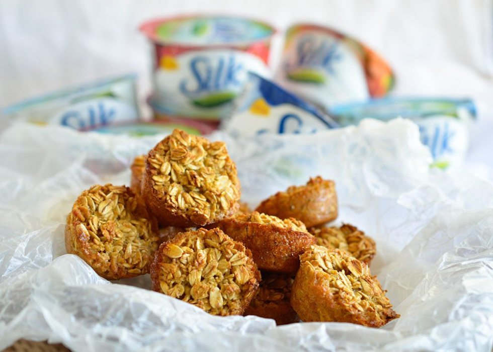 Healthy Oatmeal Muffin Dippers make the perfect grab n go breakfast! These mini oatmeal muffins are dairy free, gluten free and perfect for dipping into Silk Dairy-Free Yogurt Alternative. A great back to school breakfast recipe!