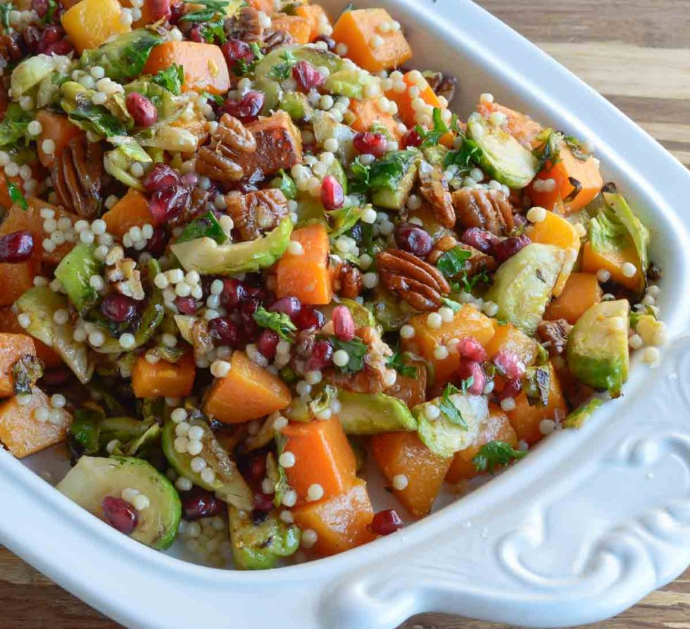Butternut Squash Pasta Salad is a healthy holiday side dish! This vegan recipe is full of fresh winter produce: butternut squash, brussels sprouts, pomegranate seeds, pecans and pasta. All topped with fresh orange and maple dijon vinaigrette!