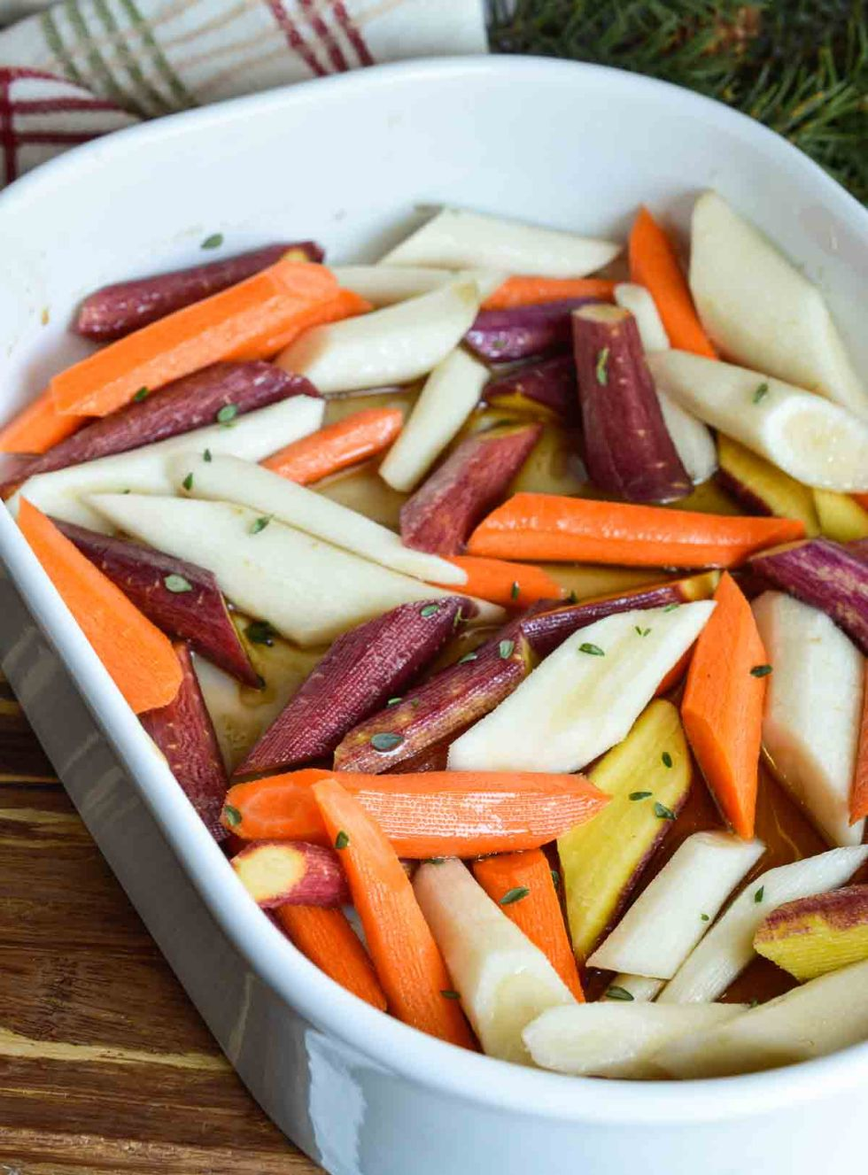 Enjoy your favorite holiday side dish without the guilt. These Healthy Candied Carrots are roasted with olive oil, maple syrup and thyme. Sweet and salty roasted carrots will be a new family favorite! Vegan, Vegetarian