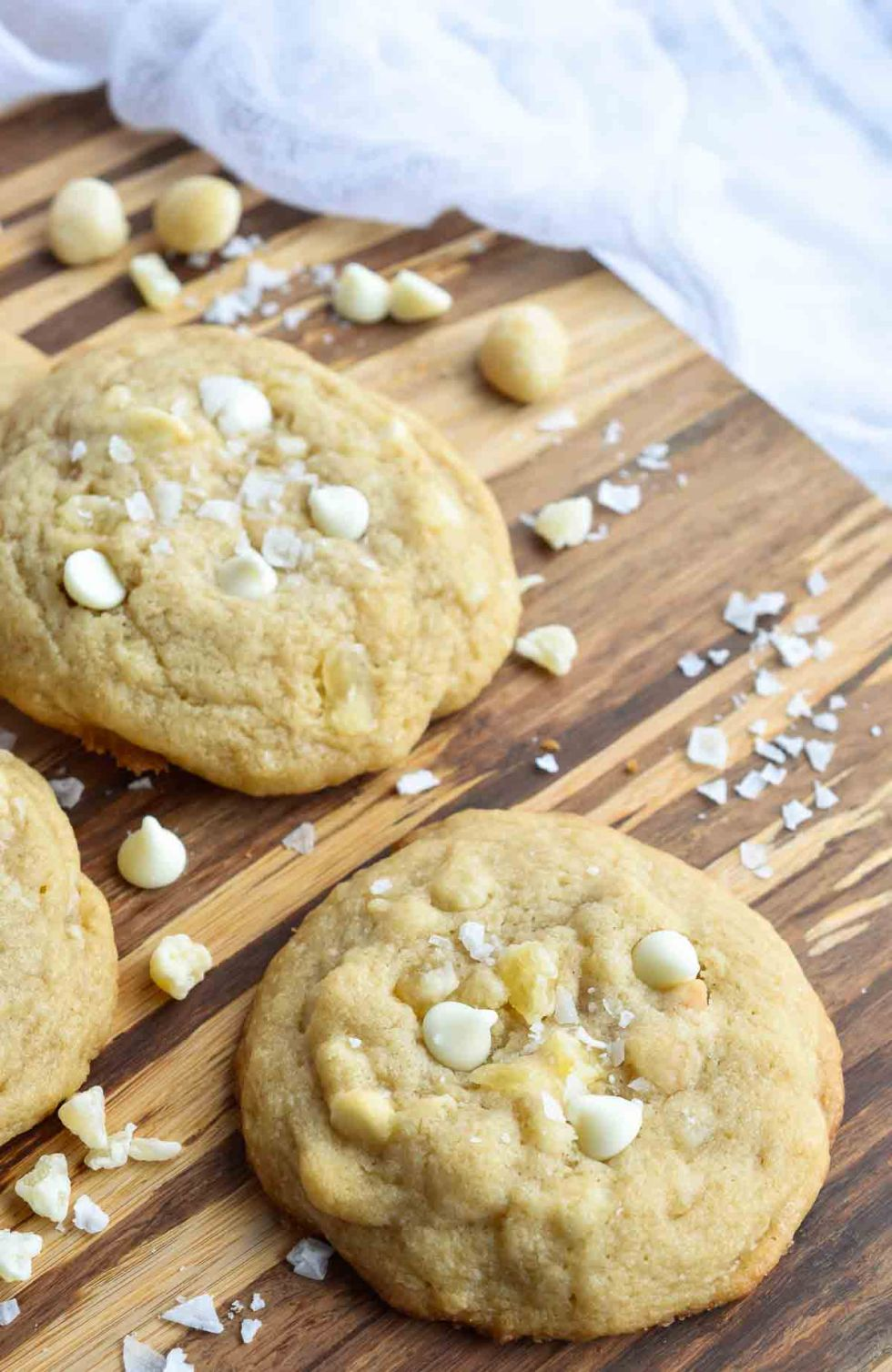 These Pineapple and White Chocolate Macadmia Nut Cookies are a great addition to any holiday dessert platter. This easy homemade cookie recipe is full of island flavor! Dried pineapple, white chocolate chips, macadamia nuts and flaked sea salt make the perfect combination.