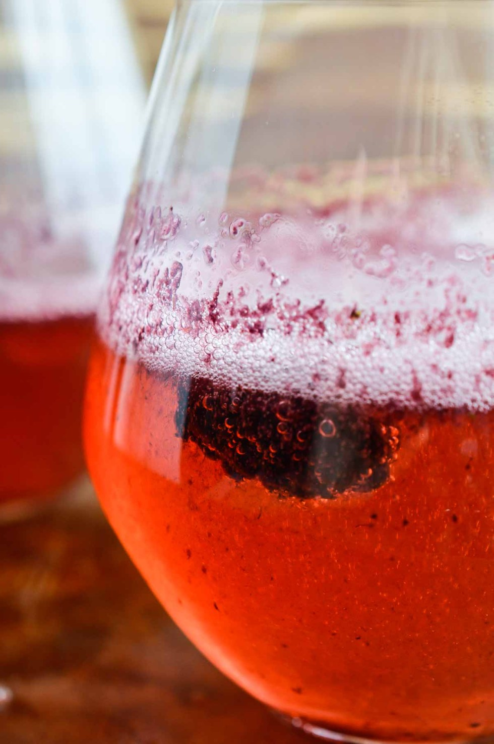 Toast to the New Year with this Blackberry Bellini Recipe. These bellini cocktails are also great for brunch! A simple blend of blackberry puree and prosecco or champagne.