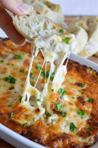 This Hot Cheesy Onion Dip Recipe is perfect for parties, holidays or game day! Melted cheese and caramelized onions in a creamy obey-gooey dip. The best appetizer EVER!