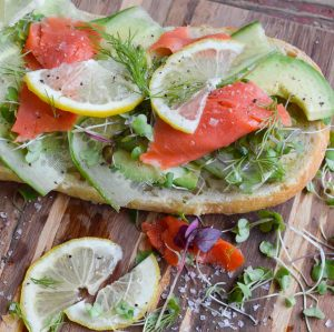Make lunchtime extra special with this Smoked Salmon Avocado Toast. Crusty artisan bread topped with avocado, cucumber, micro greens, smoked salmon, lemon and dill. An easy recipe that is full of flavors!