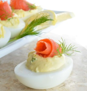 This Smoked Salmon Deviled Eggs Recipe is the best way to use those leftover Easter eggs! Creamy deviled eggs topped with smoked salmon, dill and lemon. These are perfect for any brunch or holiday feast!