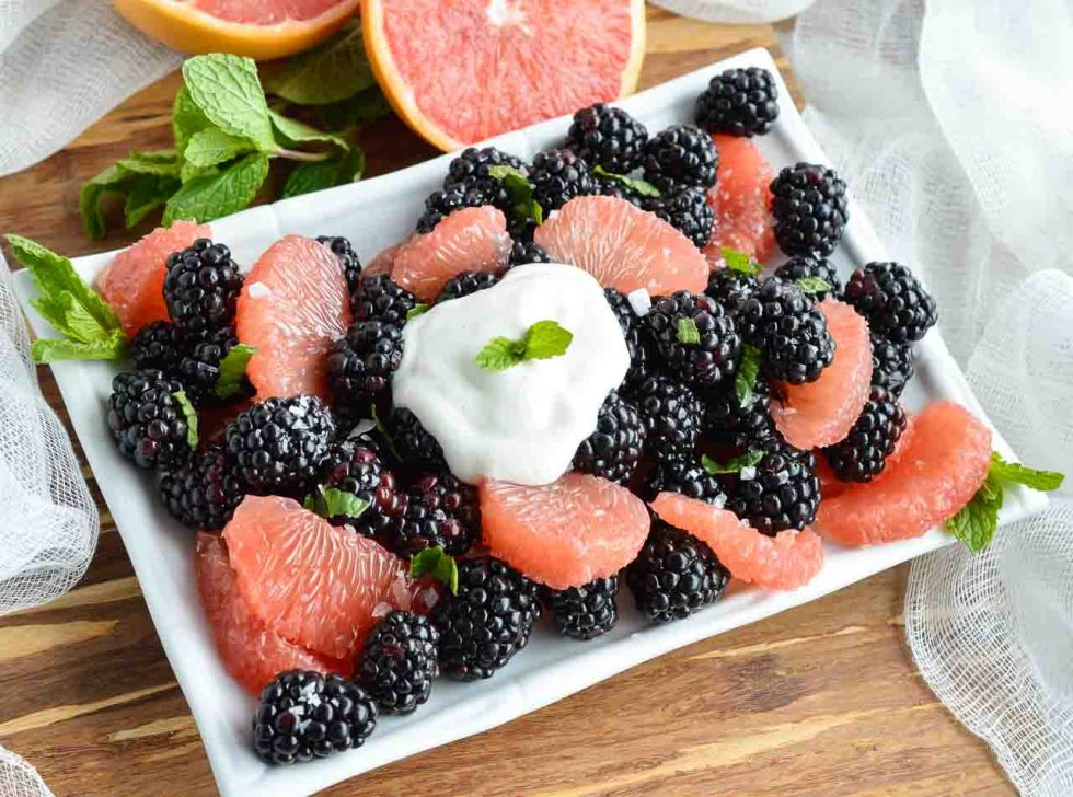 Start your day with this Easy Fresh Fruit Salad Recipe. A simple combination of sweet blackberries, tangy grapefruit, fresh mint and creamy Greek yogurt. The perfect healthy breakfast, snack or side dish!
