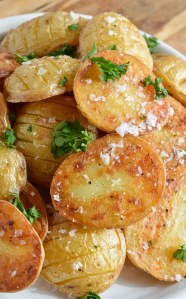 These Simple Oven Roasted Potatoes are absolute potato perfection! Golden brown and crispy on one side, creamy and dreamy on the other. This recipe is great as a side dish for just about any meal!