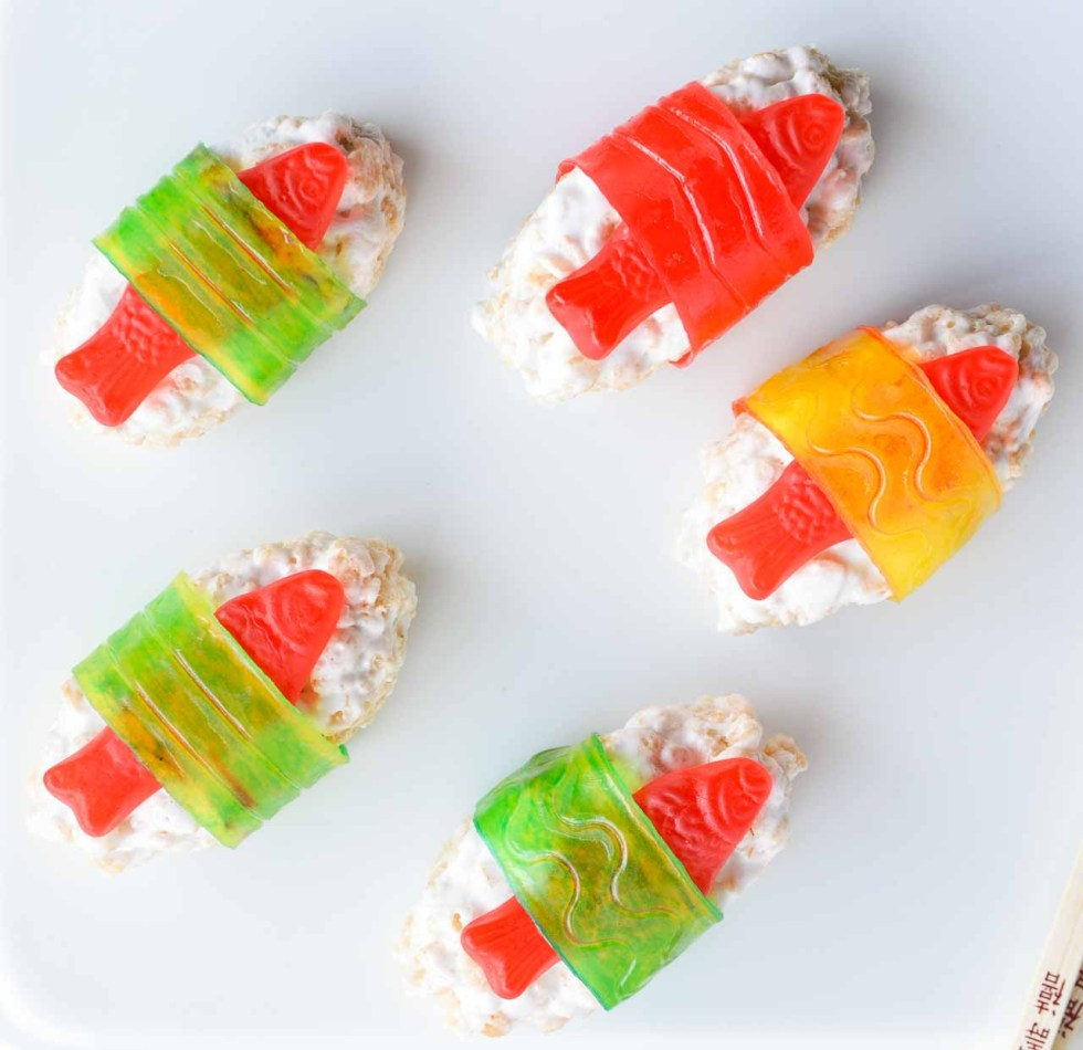 The kids will go crazy for this Candy Sushi! Made with rice crispy treats, Swedish fish candy and fruit roll ups. This dessert sushi recipe is easy to make, portable and great for parties.