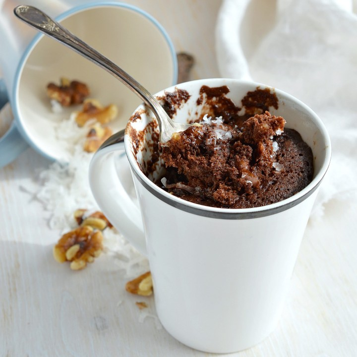 Craving chocolate and need a quick dessert fix? This Egg-Free, Dairy-Free German Chocolate Mug Cake Recipe is the solution! You read that right. No eggs. No dairy. And this vegan chocolate cake is made in 5 minutes!