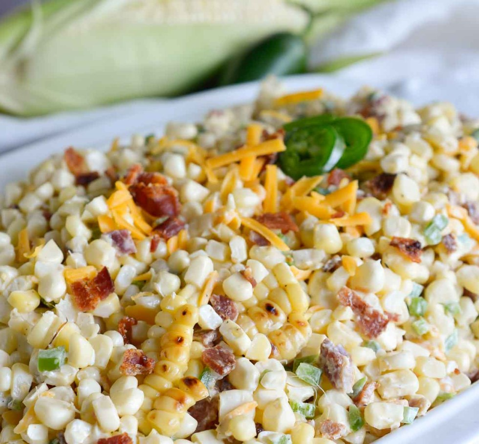 Bring on Summer and Barbecue season! This Jalapeño Popper Grilled Corn Salad Recipe brings so many great flavors together in one amazing side dish! Fresh grilled corn, bacon, jalapeño and cheddar cheese in a creamy summer salad.