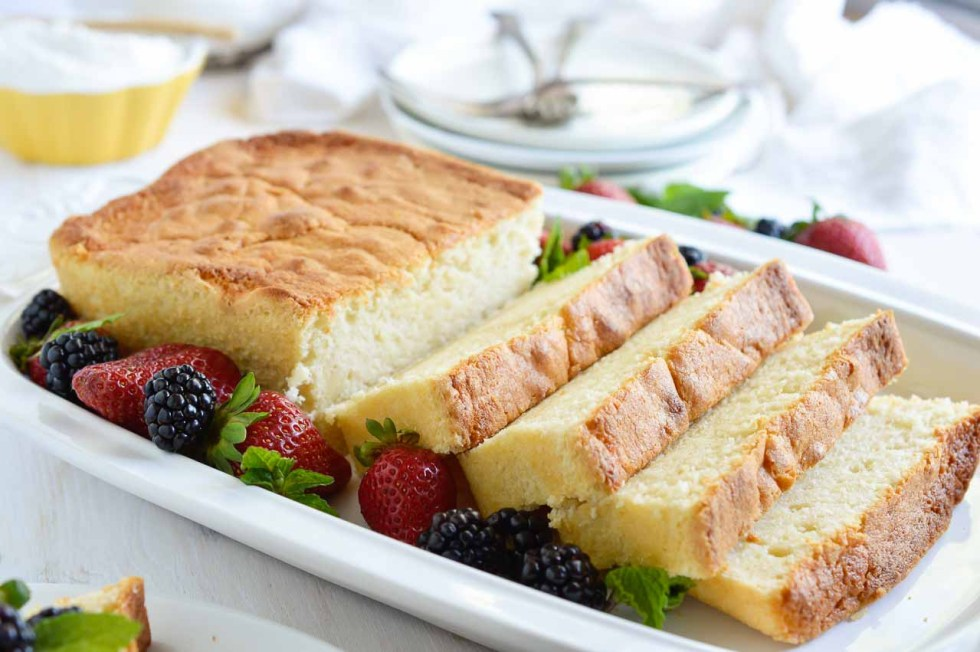 Make this Amaretto Pound Cake Recipe with Whipped Mascarpone for a simple and indulgent dessert. This easy homemade cake is flavored with almond and amaretto then baked in a loaf pan. Serve with fluffy whipped vanilla mascarpone cheese and fresh berries for a gorgeous sweet treat!