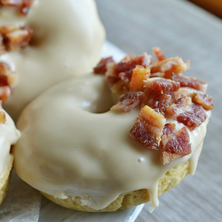 These Maple Bacon Donuts have to be one of the best flavor combinations ever! Brown sugar baked donuts with a pure maple syrup glaze then topped with brown sugar maple glazed bacon pieces. This breakfast recipe is the ultimate morning indulgence and perfection with a cup of coffee!