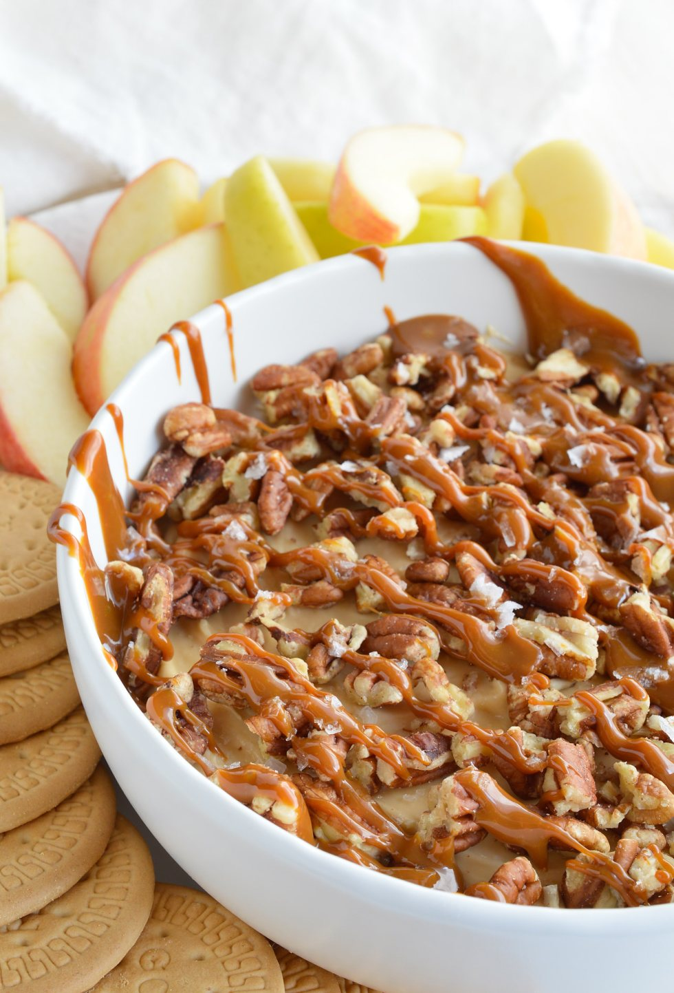 cheesecake dip drizzled with caramel sauce