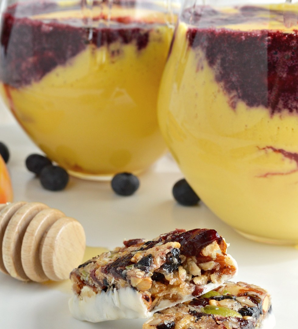 If you enjoy healthy smoothie recipes and unexpected flavor combinations these Peach Smoothies with Wild Blueberry Swirl are for you! Fresh peaches and frozen wild blueberries make a delicious and beautiful meal. vegetarian
