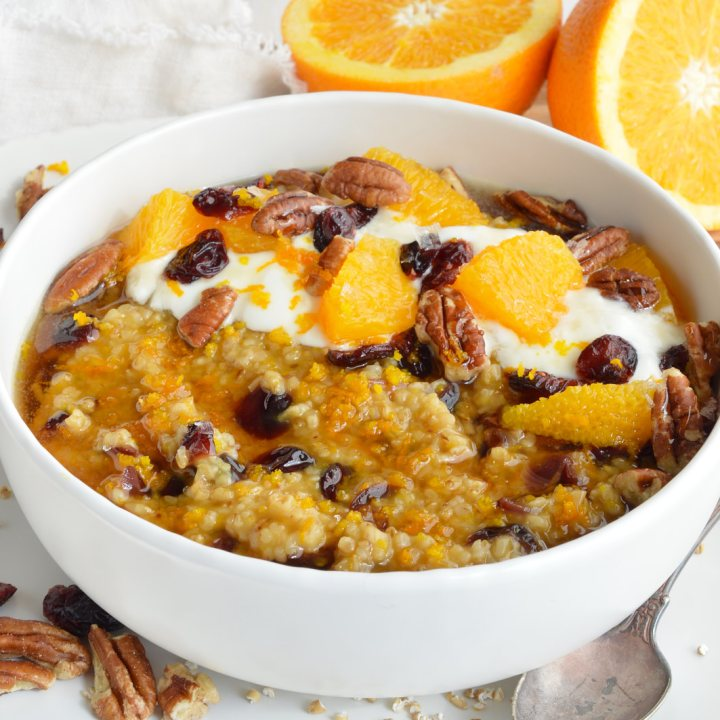 This Cranberry Orange Steel Cut Oats Recipe is a quick, easy, gluten free and healthy homemade breakfast. Stovetop oatmeal flavored with fresh squeezed orange juice and dried cranberries. What a great way to start your morning, especially when it is cold outside!