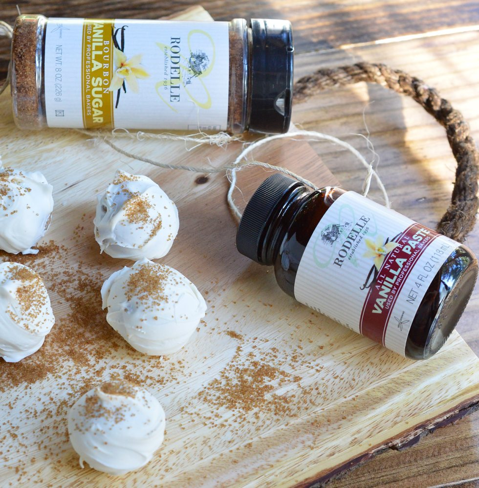 Another great no-bake holiday dessert! This Vanilla Cookie Balls Recipe is perfect for those folks that aren't all about the chocolate. Vanilla wafer, cream cheese and vanilla bean paste formed into balls then coated with white candy and bourbon vanilla sugar!