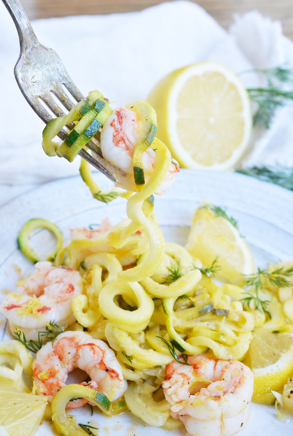 This Lemon Dill Shrimp Zucchini Noodle Recipe is a great way to start the New Year! A great lunch or dinner that is healthy, filling and Whole30 compliant. Shrimp and zoodles tossed with a lemon dill sauce makes a flavorful, nutritious meal with just 5 ingredients!