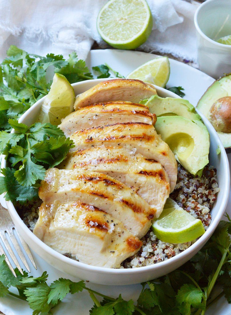 over head photo of sliced chicken breast over quinoa