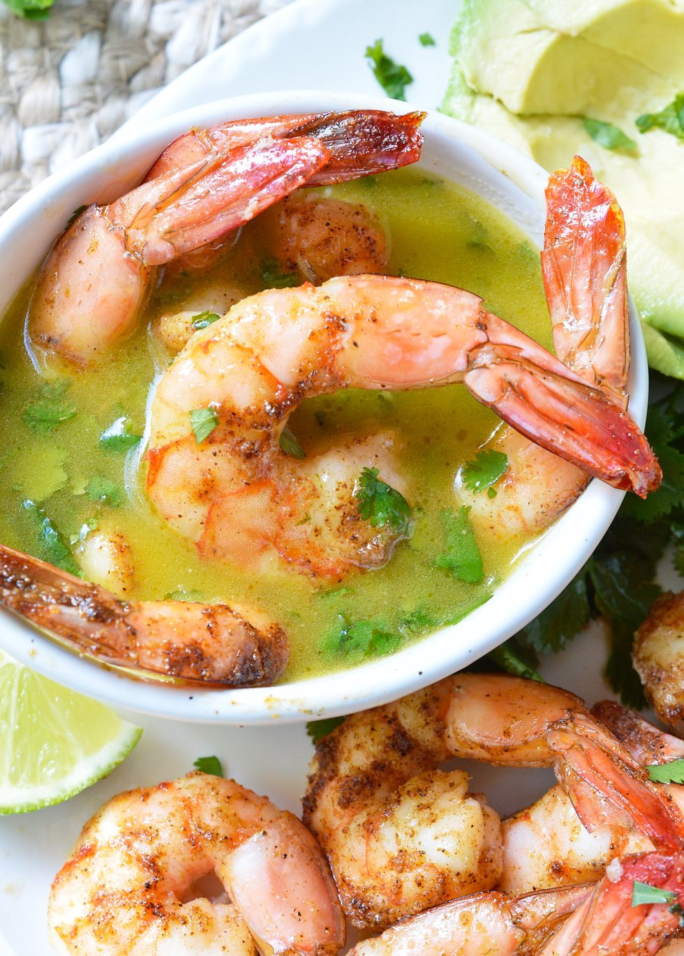 For punch in the face flavor, make these Cilantro Lime Spicy Baked Shrimp! This Whole30 compliant recipe starts with shrimp covered in spices, baked to perfection then served with a fresh cilantro lime dip. Perfect for a healthy lunch, dinner, appetizer or a snack! #whole30recipes #paleodiet #glutenfree #dairyfree #shrimprecipe