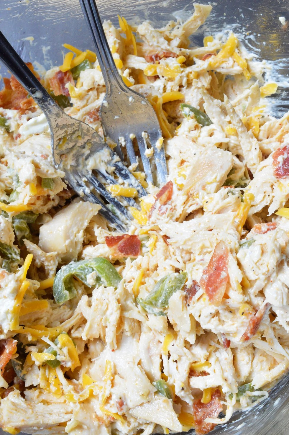 This Jalapeño Popper Chicken Salad is the ultimate! Creamy chicken salad with roasted jalapeños, bacon and cheddar cheese. Say goodbye to boring ol' chicken sandwiches and have Jalapeño Popper Chicken Wraps instead.