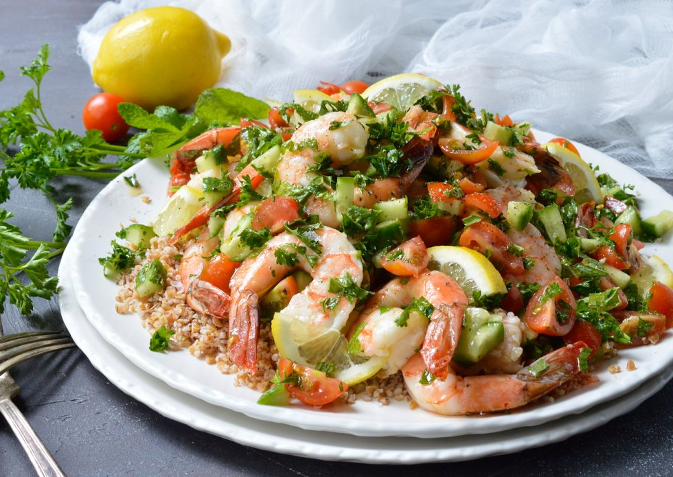 Looking for a healthy, nutritious meal with tons of flavor? This Tabouli Shrimp Salad Recipe has it all! Made with the traditional tabbouleh ingredients of mint, parsley, lemon, tomatoes, cucumber and lemon. The addition of shrimp makes this a satisfying meal that is great for lunch or dinner.
