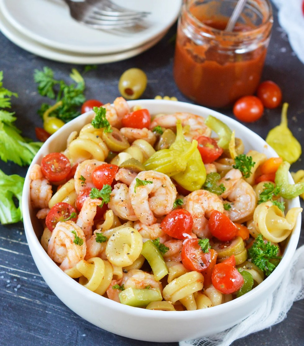 If you are looking for bold and unique flavors, this Bloody Mary Shrimp Pasta Salad Recipe will be a hit! This cold shrimp pasta salad has no mayo and all the great flavors of a Bloody Mary cocktails, without the vodka. This is a perfect party side dish!