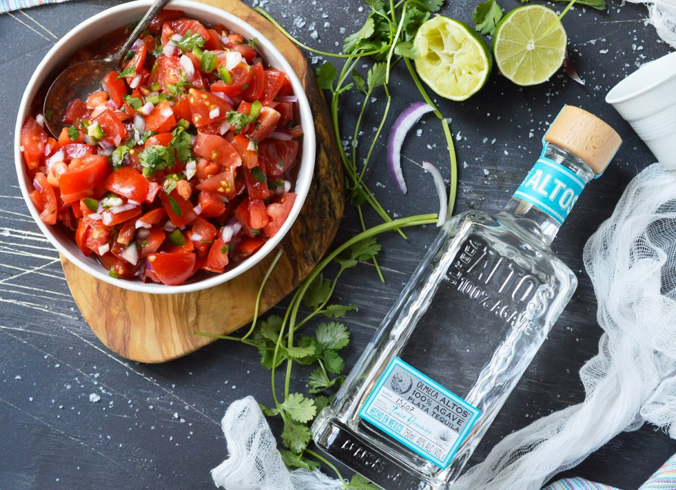 Start the summer off right with Fresh Homemade Pico de Gallo that is spiked with Tequila. Perfect for a party appetizer or a tasty snack by the pool! This salsa is great with chips or use it as a fresh, flavorful condiment. Omit the tequila and this recipe is Paleo & Whole30 friendly, grain free, gluten free, vegan, vegetarian and dairy free.