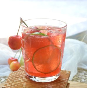 Warm summer days can only get better with this refreshing Cherry Lime Tequila Cocktail! This simple summertime drink recipe is made with fresh lime, tart cherry juice, tequila and 7UP. Perfect for entertaining or a day at the lake!