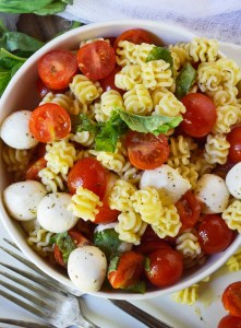 Caprese Pasta Salad Recipe is a simple yet flavorful side dish. This pasta salad is filled with mozzarella, tomatoes and basil. Tossed with an Italian oil dressing and topped with balsamic glaze.