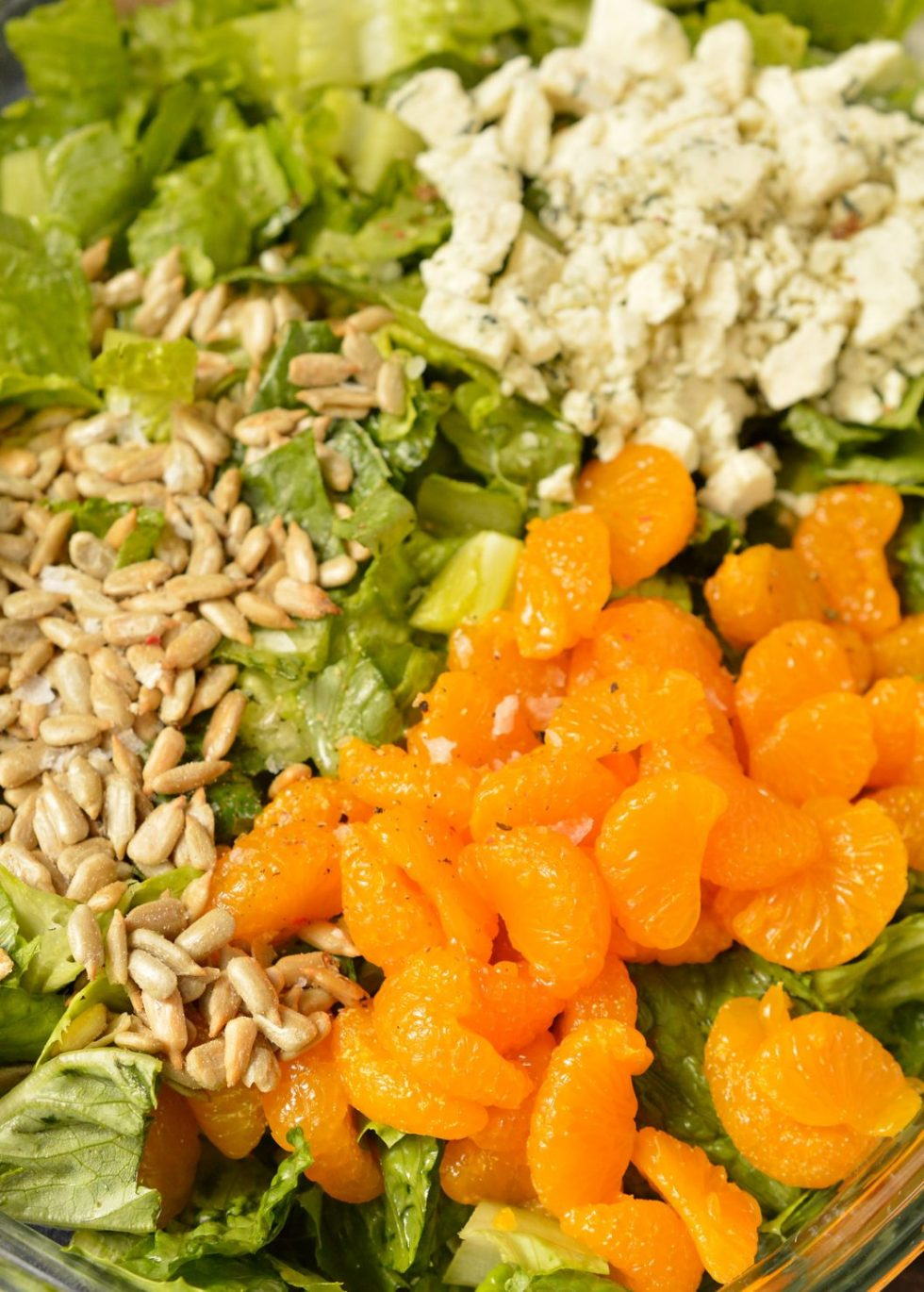 ThisBalsamic Mandarin Orange Salad may seem like an odd combo, but it works! The creamy balsamic dressing, sunflower seeds, gorgonzola cheese and mandarin oranges are the perfect combo of flavors. This is one of my all-time favorite salads because there is nothing boring about this recipe!