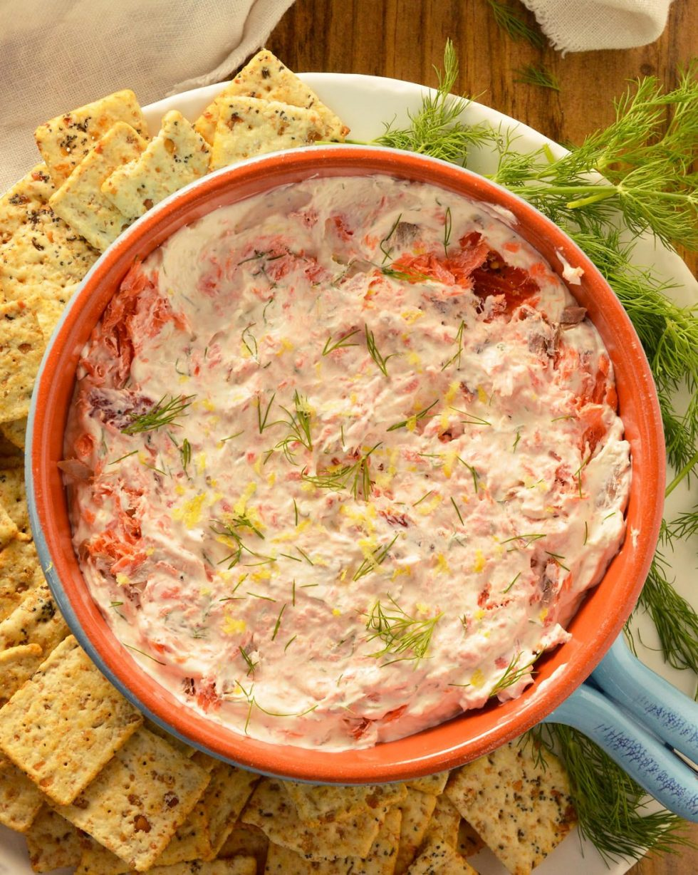 ThisSmoked Salmon Dip is one of my family's favorite holiday appetizer recipes. Every year I make this creamy dip full of smoked salmon, dill and lemon. An easy 5 minute appetizer that is sure to be a hit!