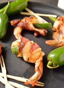 TheseBacon Wrapped Shrimp are a quick and simple appetizer, perfect for holidays, game day or parties. Just wrap shrimp and jalapeño with bacon and fry it up. These can also be made Whole30 - Paleo compliant. #whole30recipes #paleorecipes #whole30 #paleo