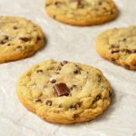 TheseSoft Chocolate Chip Cookies are my family's favorite treat! A special secret ingredient gives them a unique flavor and they are loaded with two types of chocolate chips! Also, this is a High AltitudeChocolate Chip Cookies Recipe. Soft, chewy, super-chocolaty and finished with a sprinkle of sea salt.