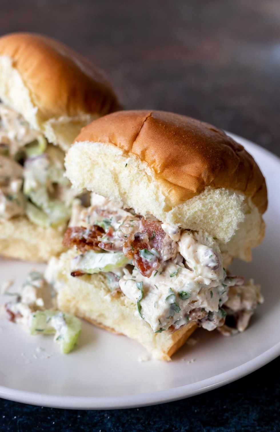 chicken salad on roll served on white plate