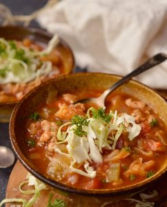 Keep warm and cozy with this Slow Cooker Cabbage Roll Soup. This soup recipe is easy, filling and healthy! Just toss a few simple ingredients into your slow cooker and dinner will be waiting for you. This is a Whole30, Paleo compliant recipe. #whole30recipes #paleorecipes #whole30 #paleo #cabbagerolls #slowcooker