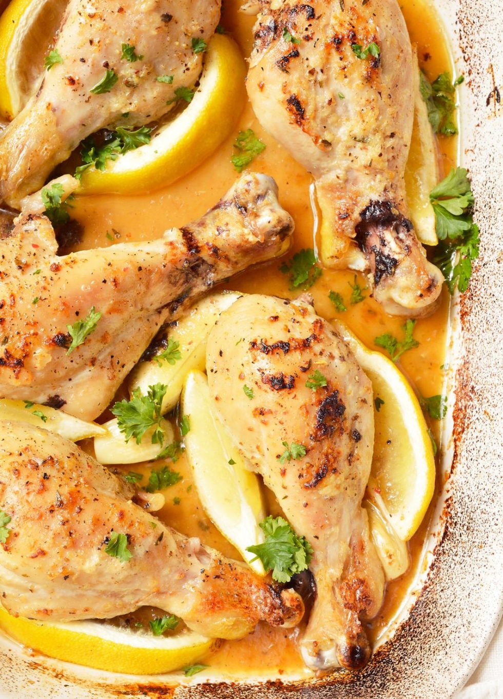 roasted chicken pieces in butter garlic lemon and parsley