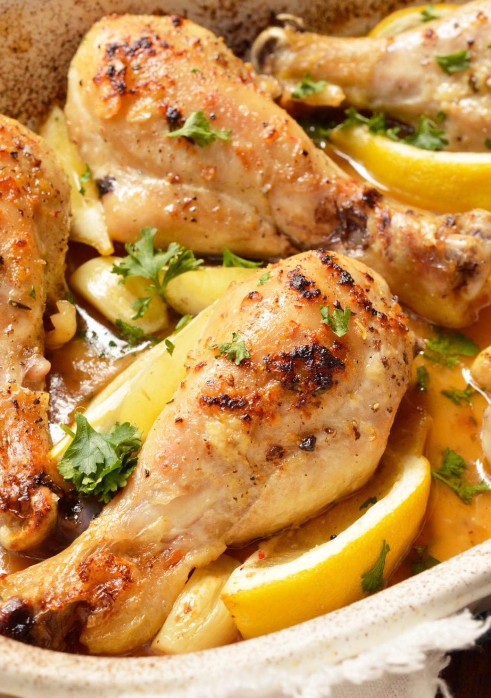 buttery lemon garlic chicken drumsticks in roasting pan