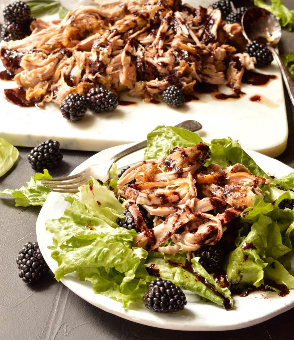 For a simple yet unique pork dinner recipe, look no further. ThisSlow Cooker Pork Tenderloin is fall apart tender and topped with a vibrant Balsamic Blackberry Sauce. Serve this over a fresh salad for a Whole30 Paleo compliant meal. If you are not following a special diet this shredded pork is great on sandwiches or tacos! #whole30recipes #paleo #porktenderloin #slowcooker