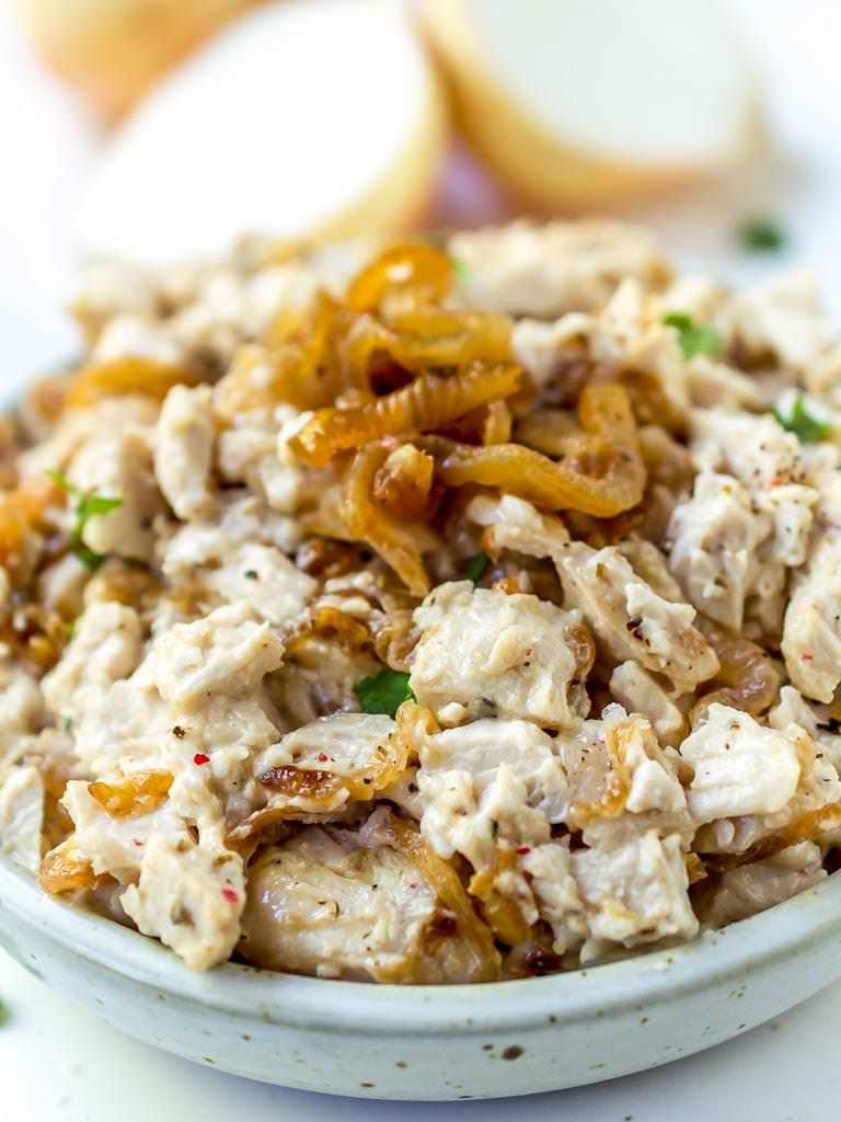 close up photo of caramelized onion paleo chicken salad topped with caramelized onions
