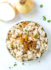 overhead photo of white bowl filled with caramelized onion paleo chicken salad