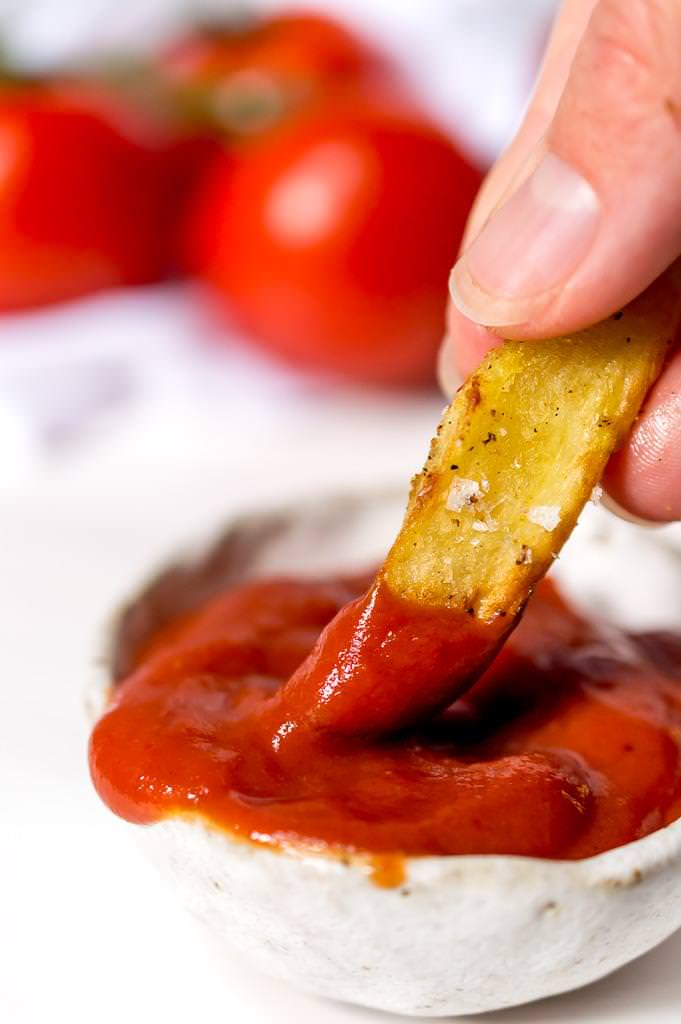 This Homemade Ketchup Recipe is Paleo and Whole30 compliant, quick, easy and tastes fantastic! Made with a blend of tomato paste, fresh vine tomatoes and dates to give you that mildly sweet, non bitter ketchup flavor that you love! A healthy ketchup for all of your dipping and slathering needs. This recipe is Paleo, Whole30, dairy free, gluten free and vegan. #veganrecipes #paleorecipes #whole30recipes #ketchuprecipes