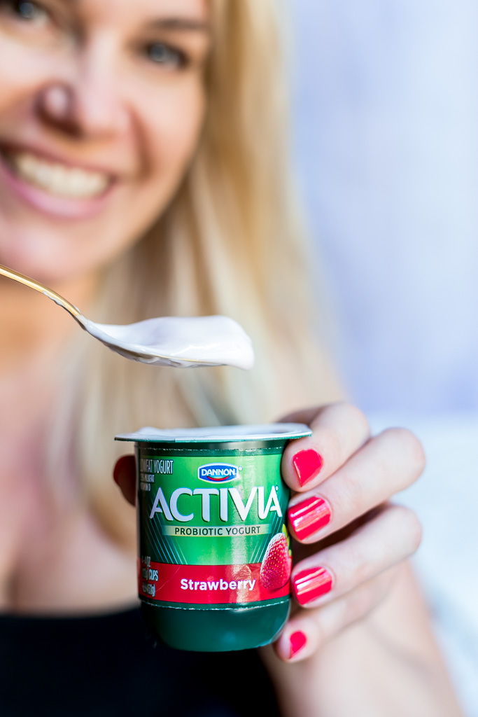 blond lady with activia yogurt and a spoon