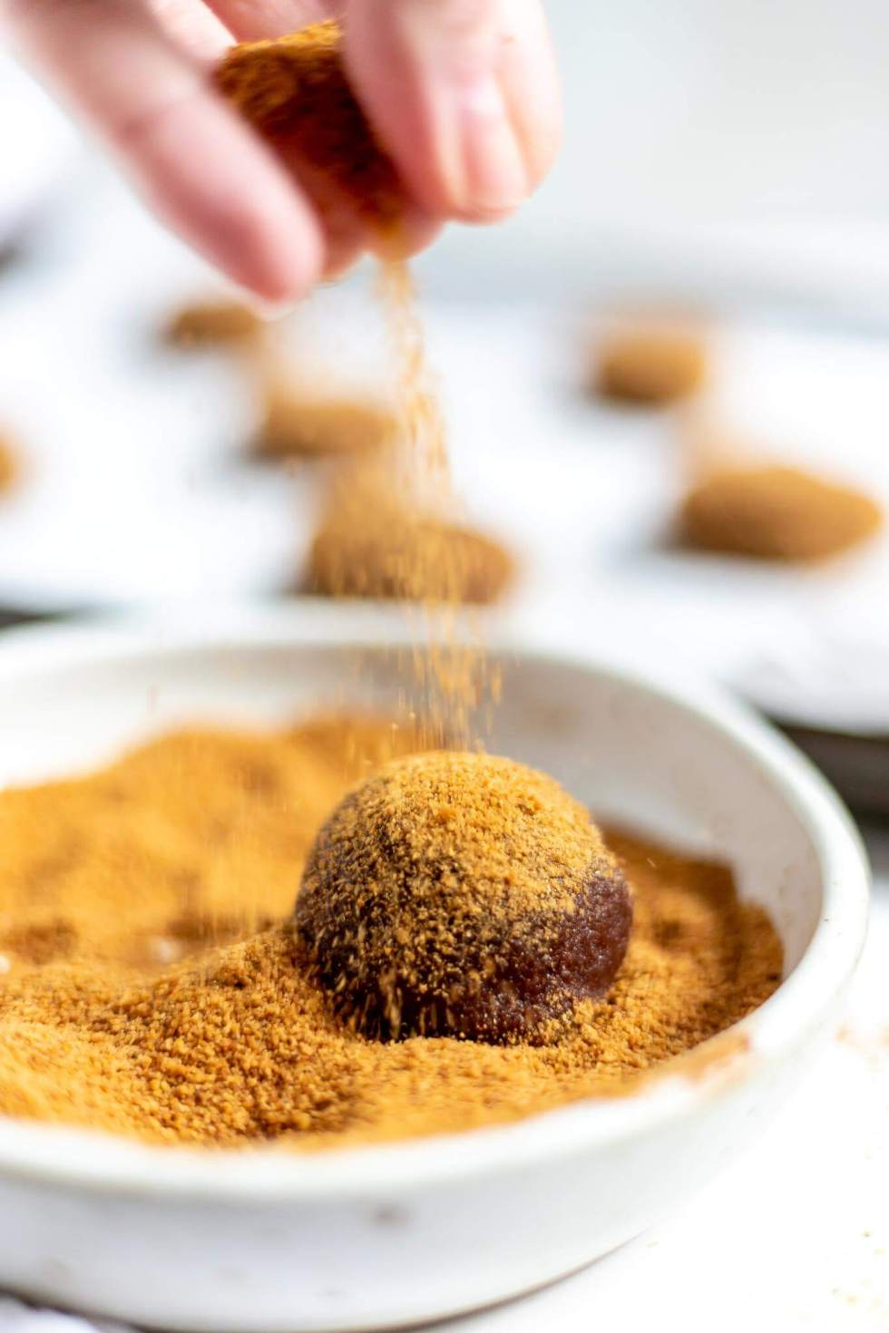 ginger cookie dough being sprinkles with coconut sugar