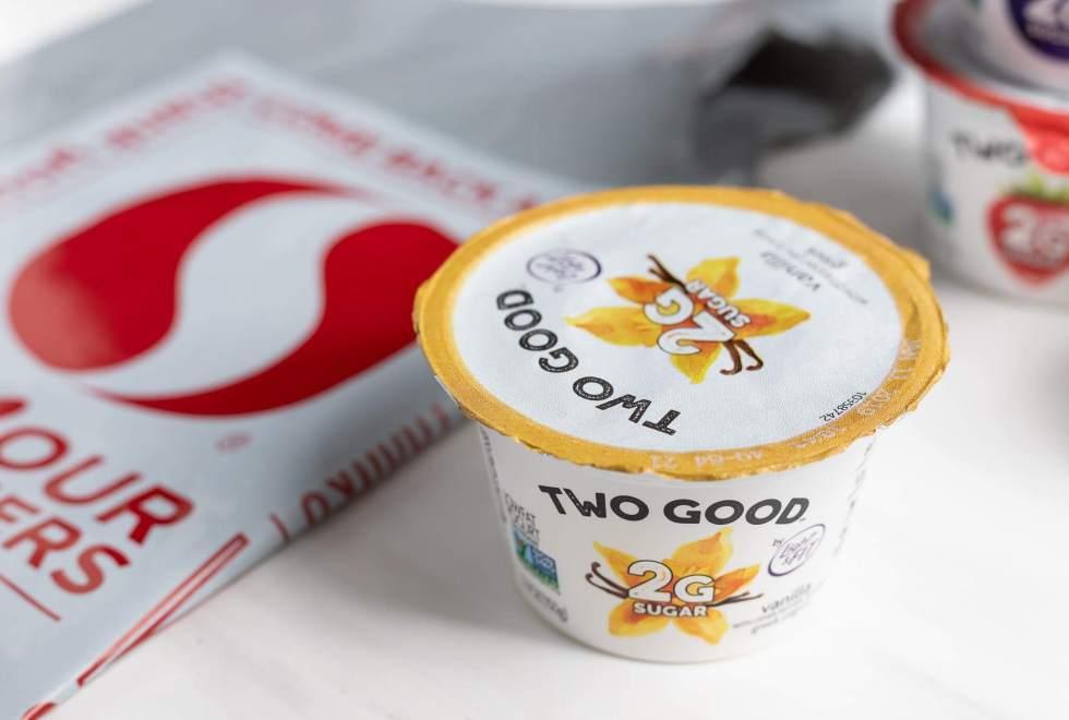 two good yogurt container next to safeway bag