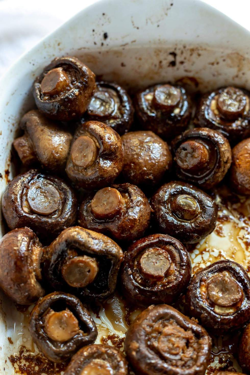 roasted mushrooms in white roasting dish