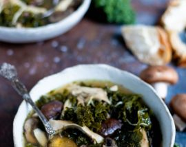 mushroom kale instant pot chicken soup in white bowl with bread on the side