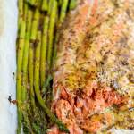 baked salmon asparagus on a parchment lined sheet pan