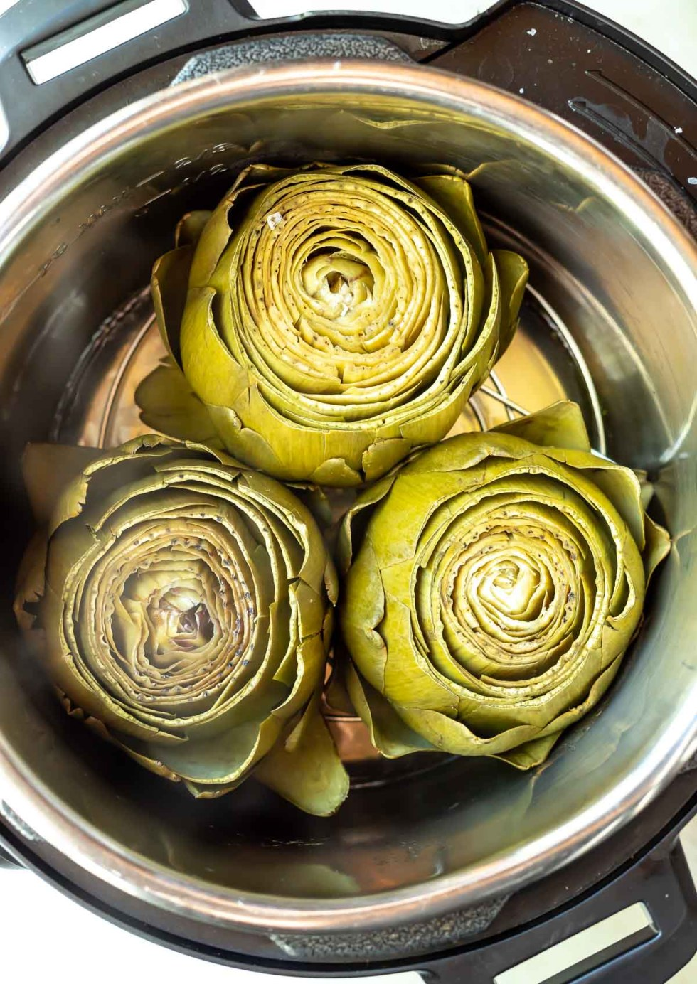 three pressure cooker artichokes in instant pot