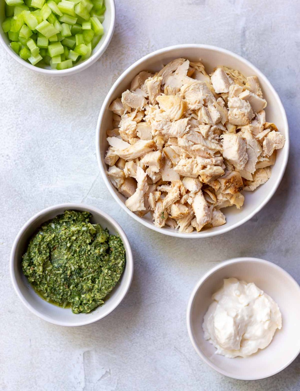 ingredients for chicken salad recipe in white bowls