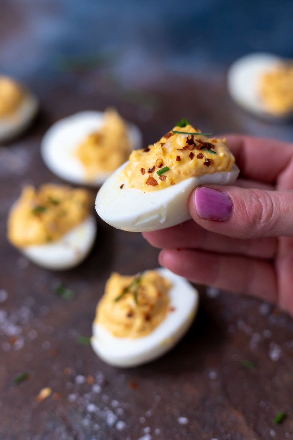 hand holding a deviled egg