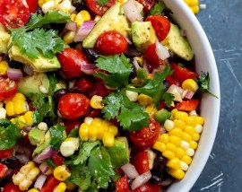 white bowl filled with fresh corn salad